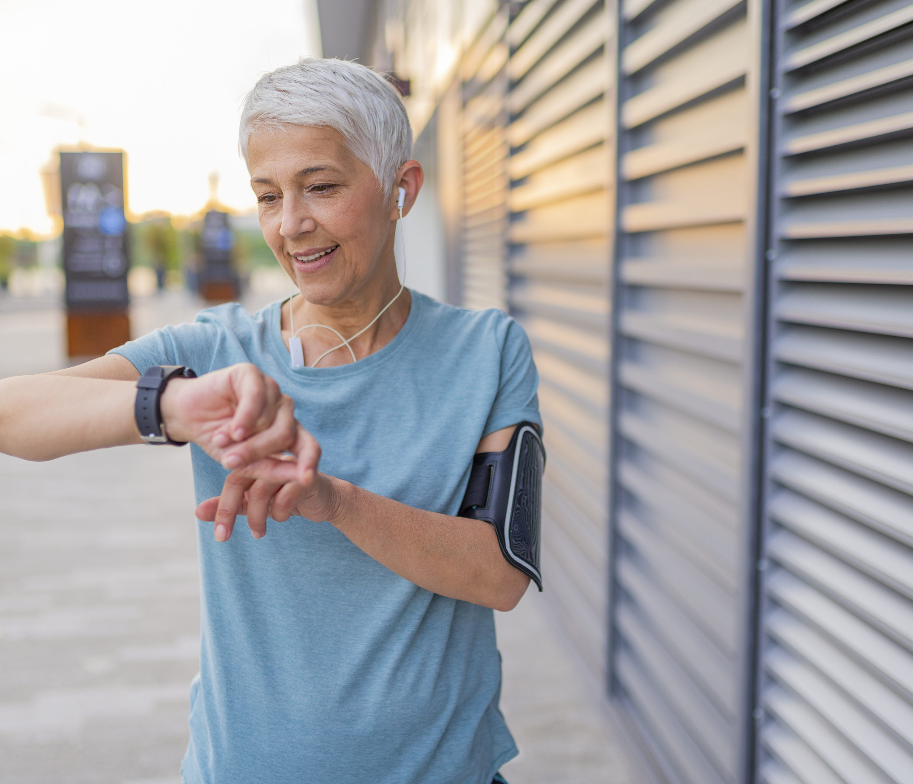 Woman exercising with smartwatch