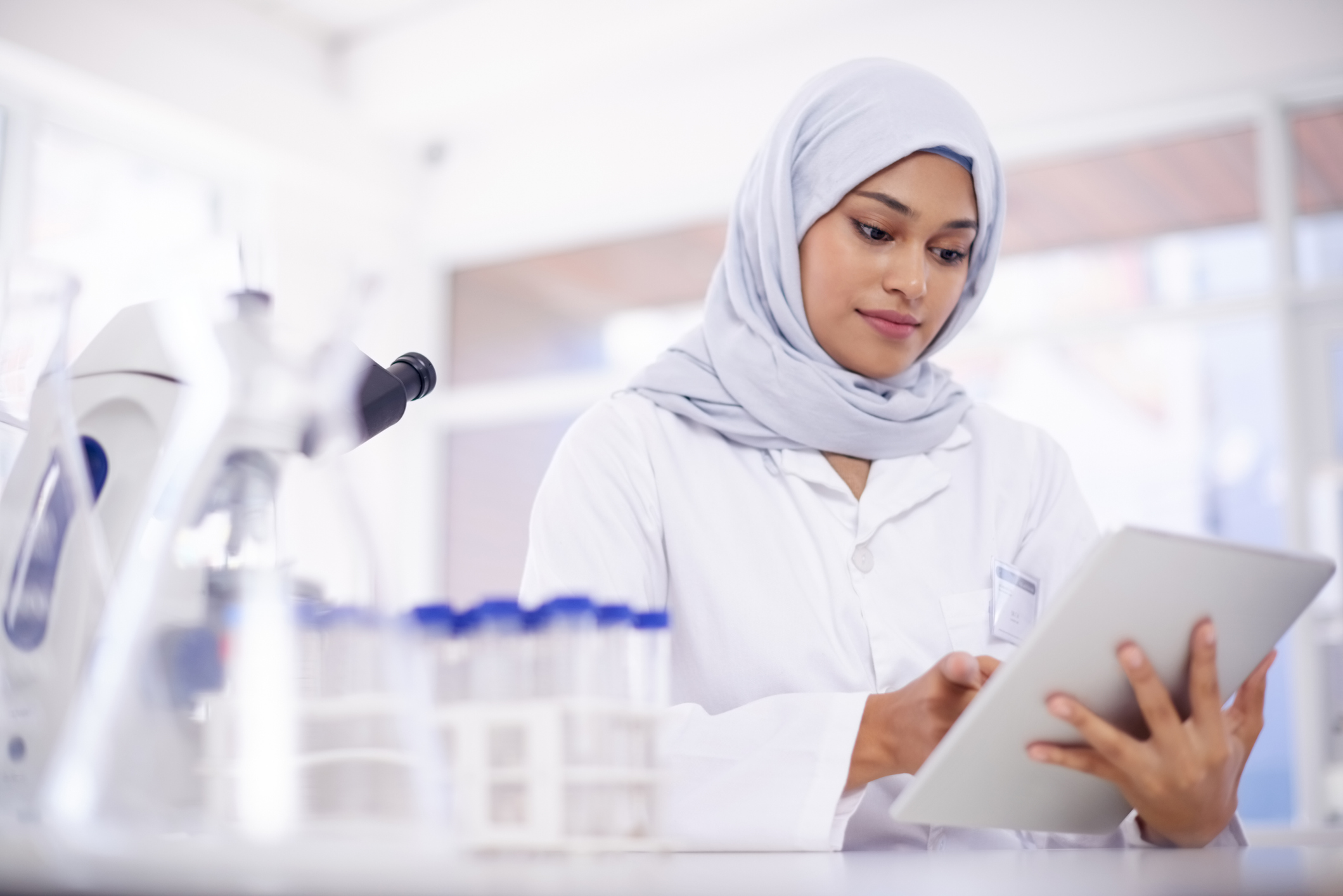 Shot of a young scientist using a digital tablet in a lab